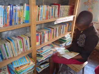 Learner reading at Bumba Primary School