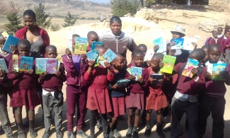Lesotho children with their lead teachers
