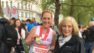 Rachel Seymour is greeted at the finish line of the London Marathon