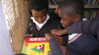 Learners reading at Qolora Education Centre