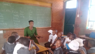 Story time at Tsoelo-Pele 'Moho Primary School reading club
